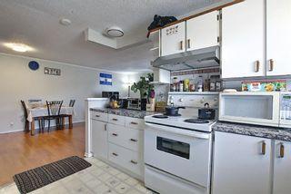 Photo 5: 180 Castledale Way NE in Calgary: Castleridge Detached for sale : MLS®# A1135509