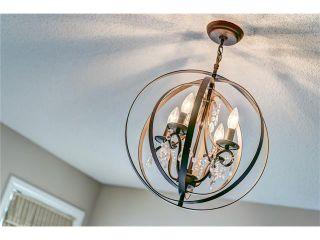 Photo 12: 109 HEARTLAND Way: Cochrane House for sale : MLS®# C4044449