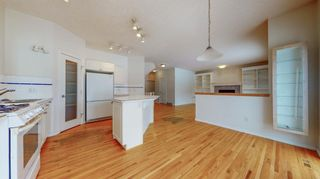 Photo 12: 48 Moreuil Court SW in Calgary: Garrison Woods Detached for sale : MLS®# A1075333