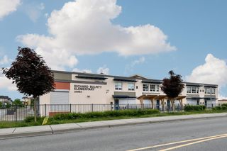 """Photo 34: 21038 77A Avenue in Langley: Willoughby Heights Condo for sale in """"IVY ROW"""" : MLS®# R2474522"""