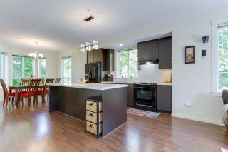 """Photo 6: 110 2418 AVON Place in Port Coquitlam: Riverwood Townhouse for sale in """"LINKS"""" : MLS®# R2583576"""