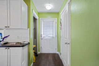 Photo 6: 102 140 Sagewood Boulevard SW: Airdrie Row/Townhouse for sale : MLS®# A1141135