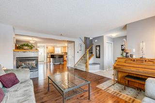 Photo 7: 239 Evermeadow Avenue SW in Calgary: Evergreen Detached for sale : MLS®# A1062008