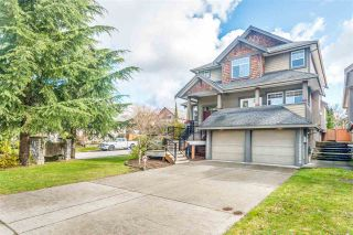 "Photo 1: 11232 BONSON Road in Pitt Meadows: South Meadows House for sale in ""BONSON'S LANDING"" : MLS®# R2556111"