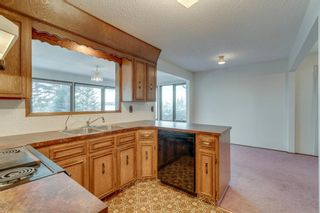 Photo 8: 7719 67 Avenue NW in Calgary: Silver Springs Detached for sale : MLS®# A1013847