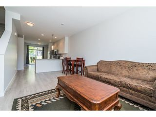 """Photo 32: 100 14555 68 Avenue in Surrey: East Newton Townhouse for sale in """"SYNC"""" : MLS®# R2169561"""