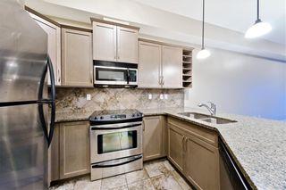 Photo 4: #423 35 ASPENMONT HT SW in Calgary: Aspen Woods Condo for sale : MLS®# C4207910