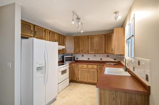 Photo 4: 47 Woodstock Road SW in Calgary: Woodlands Detached for sale : MLS®# A1142826