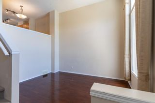 Photo 8: 119 Toscana Gardens NW in Calgary: Tuscany Row/Townhouse for sale : MLS®# A1121039