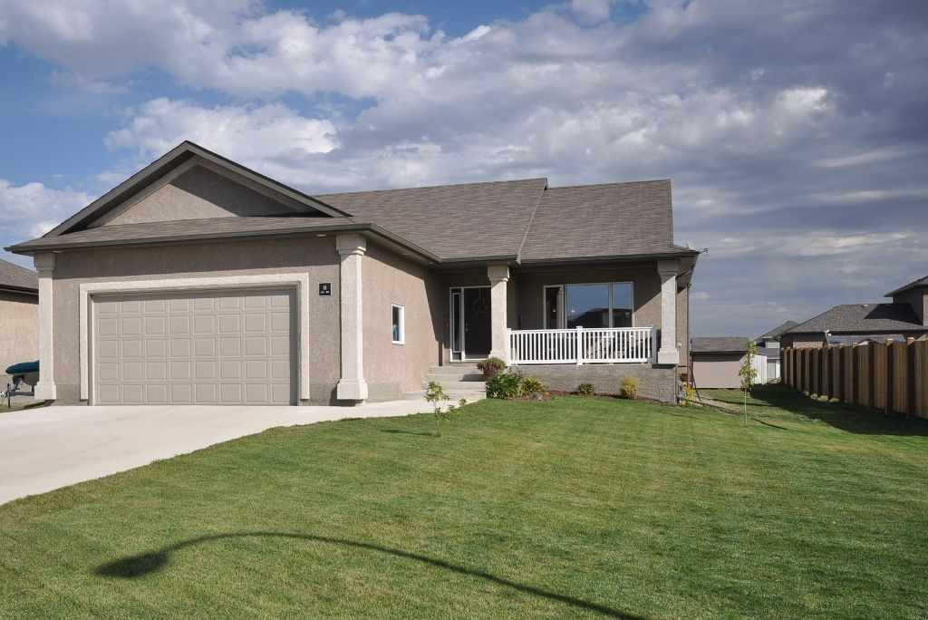 Bungalow (08) with an oversized 24x26 AT2 on a Beautifully Landscaped 80x140 lot with concrete driveway in the Sage Place Development in the Town of Oakbank.