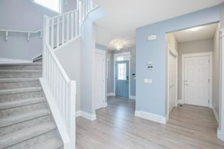 Photo 5: 48 Tremblant Terrace SW in Calgary: Springbank Hill Detached for sale : MLS®# A1131887
