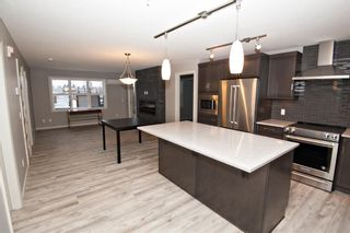 Photo 3: 2102 10 Market Boulevard SE: Airdrie Apartment for sale : MLS®# A1054506
