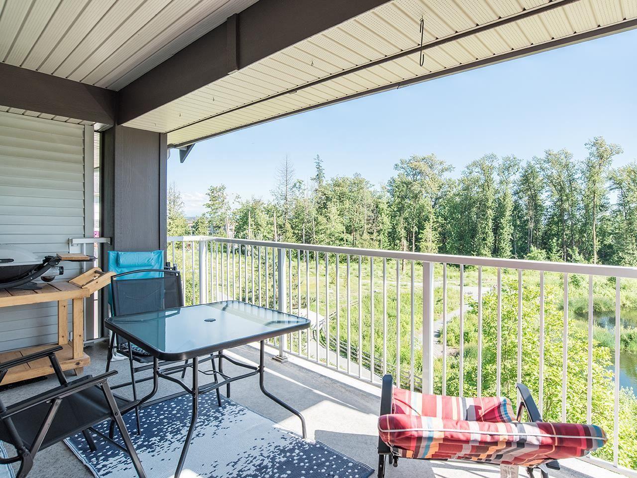 "Main Photo: 309 19340 65 Avenue in Surrey: Clayton Condo for sale in ""ESPIRIT AT SOUTHLANDS"" (Cloverdale)  : MLS®# R2593746"