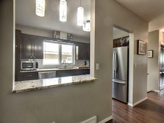 Photo 2: 1608 19 Avenue NW in Calgary: Capitol Hill Semi Detached for sale : MLS®# A1118692