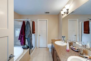 Photo 32: 208 Sunset View: Cochrane Detached for sale : MLS®# A1136470