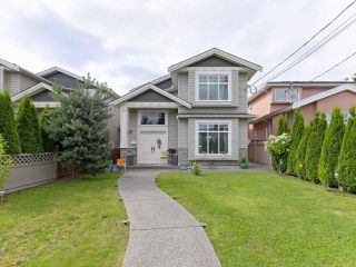 Photo 1: 7115 10TH Avenue in Burnaby: Edmonds BE 1/2 Duplex for sale (Burnaby East)  : MLS®# R2480070