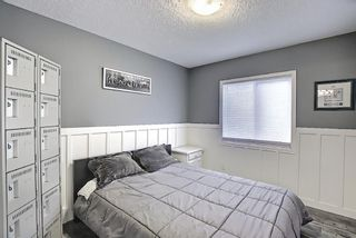 Photo 25: 570 River Heights Crescent: Cochrane Semi Detached for sale : MLS®# A1090524