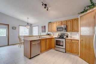 Photo 12: 60 Woodside Crescent NW: Airdrie Detached for sale : MLS®# A1110832