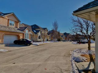 Photo 30: 11 26 Quigley Drive: Cochrane Row/Townhouse for sale : MLS®# A1062070