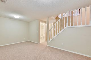 Photo 26: 105 7172 Coach Hill Road SW in Calgary: Coach Hill Row/Townhouse for sale : MLS®# A1053113