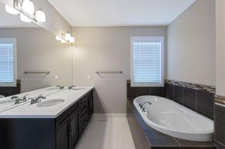 Photo 27: 144 Heritage Boulevard: Cochrane Detached for sale : MLS®# A1125296