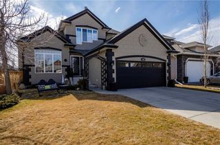 Photo 1: 1302 STRATHCONA Drive SW in Calgary: Strathcona Park Detached for sale : MLS®# C4235711