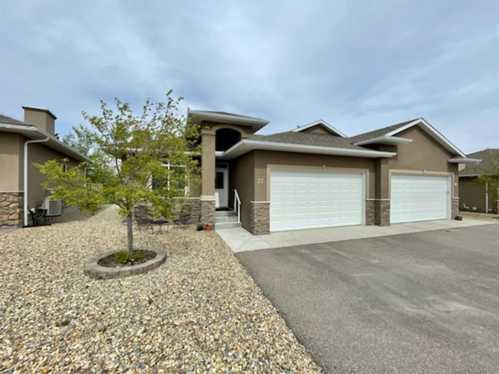 Main Photo: 37 River Heights View: Cochrane Semi Detached for sale : MLS®# A1113108