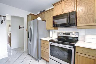 Photo 21: 30 Wakefield Drive SW in Calgary: Westgate Detached for sale : MLS®# A1136370