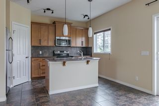 Photo 14: 296 Sunset Point: Cochrane Row/Townhouse for sale : MLS®# A1134676