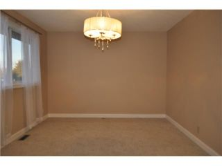 Photo 5: 557 SUMMERWOOD Place SE: Airdrie Residential Attached for sale : MLS®# C3592604