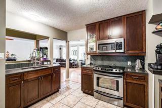 Photo 4: 82 Thornlee Crescent NW in Calgary: Thorncliffe Detached for sale : MLS®# A1146440
