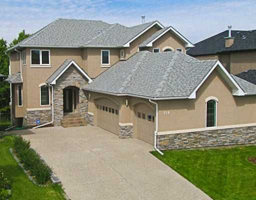 This home is brand new backing onto FISH CREEK PARK.  Triple sidecar garage with acrylic stucco and stone