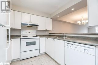 Photo 3: 117 EDGEHILL Drive Unit# 104 in Barrie: Condo for sale : MLS®# 40147841