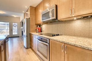 Photo 12: 206 20 Brentwood Common NW in Calgary: Brentwood Row/Townhouse for sale : MLS®# A1129948