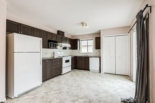 Photo 9: 6633 Pinecliff Grove NE in Calgary: Pineridge Row/Townhouse for sale : MLS®# A1128920