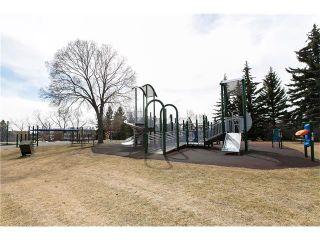 Photo 3: #1 4907 8 ST SW in Calgary: Britannia Condo for sale : MLS®# C4110034