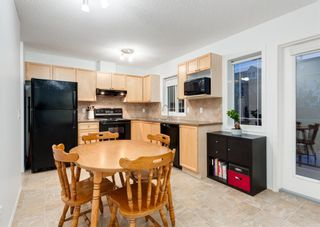 Photo 19: 218 950 ARBOUR LAKE Road NW in Calgary: Arbour Lake Row/Townhouse for sale : MLS®# A1136377