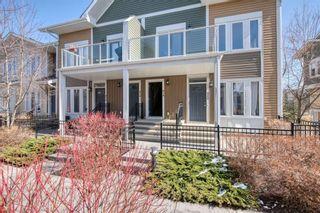 Photo 1: 818 Auburn Bay Square SE in Calgary: Auburn Bay Row/Townhouse for sale : MLS®# A1087965