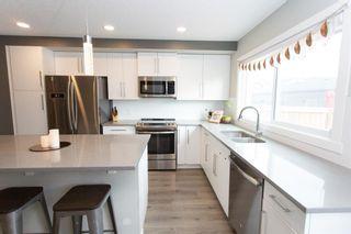 Photo 6: 179 Fireside Way: Cochrane Row/Townhouse for sale : MLS®# A1109604