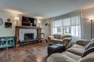 Photo 2: 128 Cedarpark Green SW in Calgary: Cedarbrae Detached for sale : MLS®# A1109711