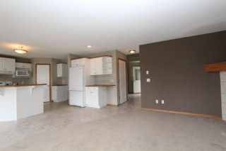 Photo 9: 180 FAIRWAYS Drive NW: Airdrie Residential Detached Single Family for sale : MLS®# C3526868