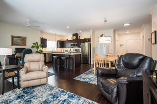 """Photo 7: 411 20281 53A Avenue in Langley: Langley City Condo for sale in """"Gibbons Layne"""" : MLS®# R2621680"""
