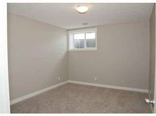 Photo 18: 130 RIVERSIDE Crescent NW: High River Residential Attached for sale : MLS®# C3612435