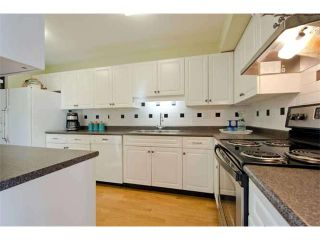 """Photo 11: 125 2721 ATLIN Place in Coquitlam: Coquitlam East Townhouse for sale in """"THE TERRACES"""" : MLS®# V1057013"""