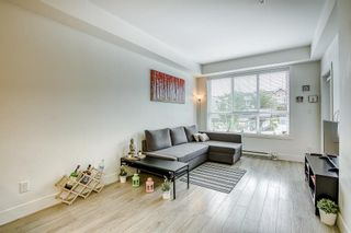 """Photo 5: 205 6468 195A Street in Surrey: Clayton Condo for sale in """"Yale Bloc Building 1"""" (Cloverdale)  : MLS®# R2456985"""