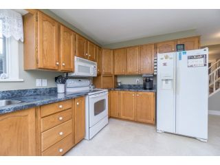 """Photo 9: 18076 58TH Avenue in Surrey: Cloverdale BC House for sale in """"CLOVERDALE"""" (Cloverdale)  : MLS®# F1440680"""