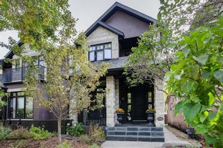 Photo 1: 216 11 Street NW in Calgary: Hillhurst Semi Detached for sale : MLS®# A1033762