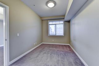 Photo 13: 211 28 Auburn Bay Link SE in Calgary: Auburn Bay Apartment for sale : MLS®# A1076356