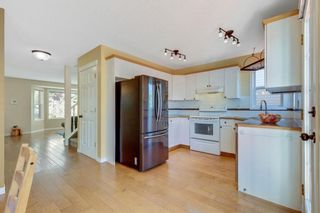 Photo 13: 322 Arbour Grove Close NW in Calgary: Arbour Lake Detached for sale : MLS®# A1115471