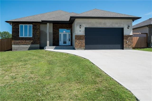 """BRIGHT & SPACIOUS! OVER-SIZED FRONT DRIVE TO 23'-8"""" X 27' X 13'H  INSULATED GARAGE WITH OVER-SIZED DOOR!"""